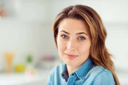 Close-up portrait of her she nice-looking lovely sweet charming cute attractive well-groomed peaceful content mature brown-haired lady in light white interior style kitchen