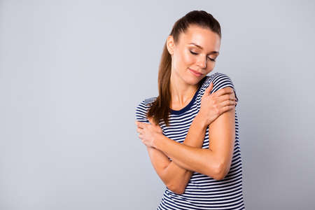 Close up photo beautiful amazing she her lady ideal overjoyed look eyes closed hold self herself hands arms purity skin skincare shoulders wear blue white striped t-shirt isolated grey background