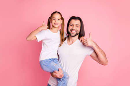 Close up photo beautiful she her little lady he him his daddy dad hold little princess hands arms thumbs up recommend rest relax wear casual white t-shirts denim jeans isolated pink bright background