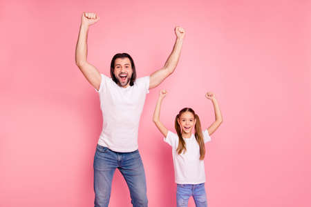 Close up photo beautiful she her little lady stand he him his single dad raise arms hands yell football goal vacation rest relax wear casual white t-shirts denim jeans isolated pink bright background Stock Photo