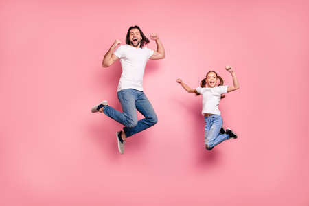 Full length body size photo funny she her little lady he him his daddy dad jump air star shape figure amazed excited scream shout yell wear casual white t-shirts denim jeans isolated pink background 写真素材 - 122177412