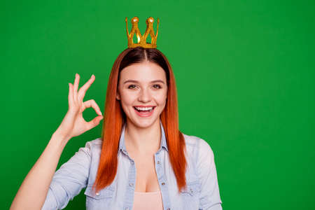 Portrait of positive satisfied excited royalty majesty laugh laughter beautiful have tiara victory suggest feedback advice choice wear jeans trendy stylish hipster isolated on green background Stockfoto