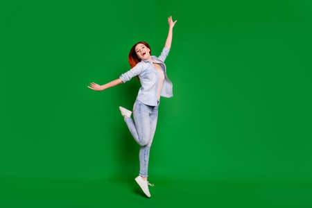 Full length body size view portrait of her she nice attractive slim fit thin cheerful cheery optimistic overjoyed girl having fun free time isolated over bright vivid shine green background