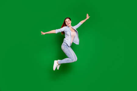 Full length body size view portrait of her she nice-looking attractive lovely slim fit thin cheerful cheery glad girl having fun time isolated over bright vivid shine green background
