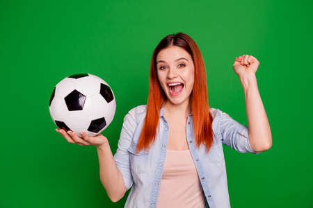 Portrait of her she nice-looking attractive cute charming lovely fascinating cheerful cheery optimistic ecstatic girl holding in hands ball isolated over bright vivid shine green background