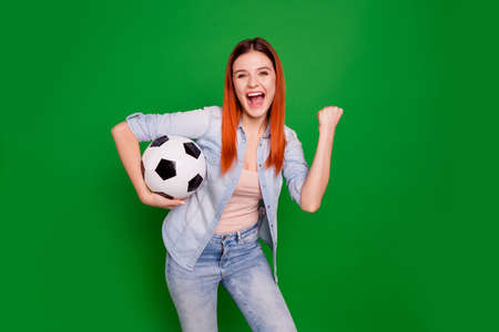 Portrait of her she nice-looking attractive cute charming lovely sporty cheerful cheery ecstatic teenage girl carrying ball isolated over bright vivid shine green background