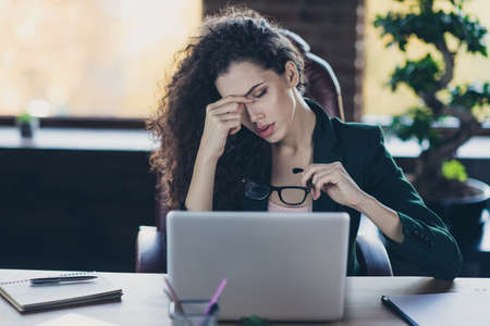 Close up photo overwhelmed beautiful pretty lady entrepreneur freelancer hard work hold hand eyewear eyeglasses spectacles use device messages email fail strategy black blazer sit chair desk loft