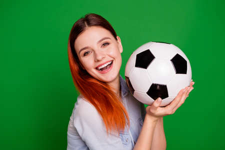 Close-up portrait of her she nice-looking attractive cute charming sweet lovely cheerful cheery positive girl holding in hands ball isolated over bright vivid shine green background Stockfoto