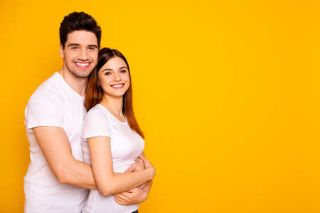 Profile side view portrait of two nice attractive lovely sweet charming cheerful cheery people enjoying spending time isolated over vivid shine bright yellow background Stock Photo