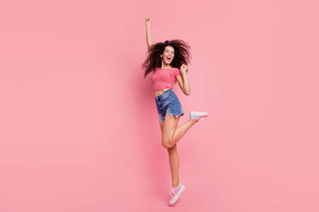 Full length body size photo of crazy cheerful positive glad satisfied in good mood screaming shouting she her lady raising fist up isolated pastel background