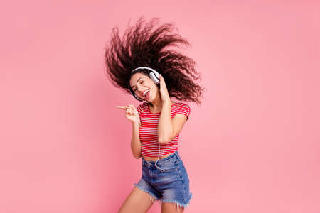 Portrait of her she nice-looking attractive cool lovely charming shine cheerful cheery glad wavy-haired girl meloman having fun time melody sound isolated over pink pastel background Stok Fotoğraf