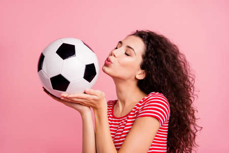 Close-up portrait of her she nice-looking attractive lovely charming sweet tender wavy-haired girl holding in hand on palm ball kissing isolated over pink pastel background