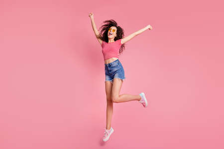 Full length body size view portrait of her she nice-looking attractive winsome charming lovely shine feminine cheerful cheery wavy-haired lady having fun isolated over pink pastel background