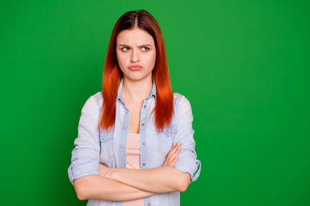 Close up photo beautiful funny expression she her foxy lady arms crossed look offense empty space not speak tell talk to you your fault wear casual jeans denim shirt isolated green bright background 版權商用圖片