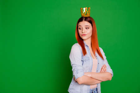 Portrait of selfish independent lady youth independent despise people person anger angry pride herself wear jeans outfit long straight hair isolated on green background