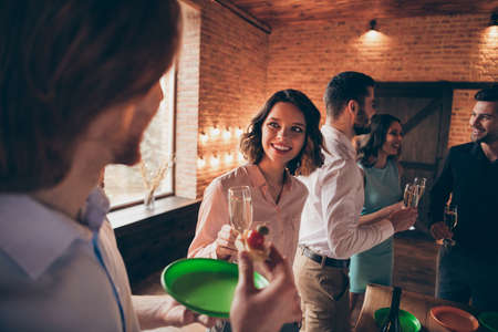 Company of nice cute charming attractive lovely pretty elegant cheerful positive guys ladies gentlemen having fun talk corporate event tradition birthday celebratory in industrial loft interior room 写真素材