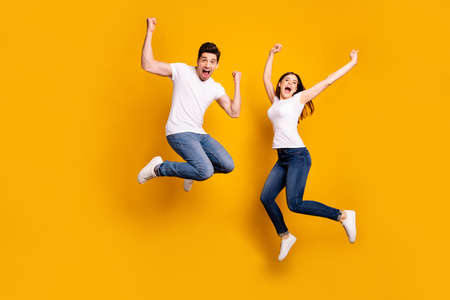 Full length body size photo yell scream shout loud cheerleader football fans wear casual jeans denim white t-shirts isolated yellow background 写真素材
