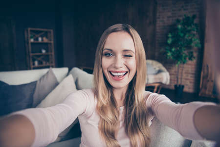 Closeup photo portrait of cheerful pretty cunning curious funny she her lady taking making self picture image having blog online video call