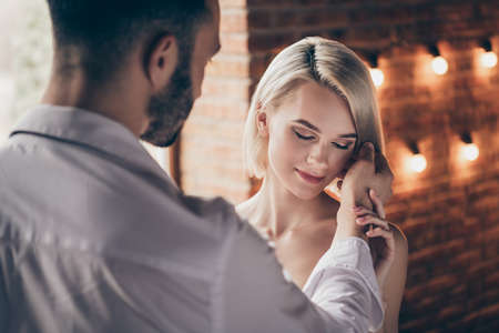 Close-up portrait of two person nice sweet adorable stunning shine gorgeous attractive lovely lovable lady having romance with guy pleasure in loft brick industrial style interior room house