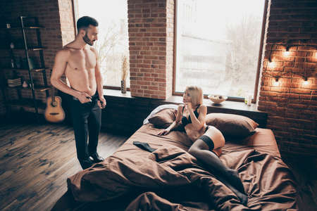 His he her she nice attractive lovely lovable gorgeous adorable feminine slim fit thin slender lady waiting sportive muscular guy healthy life in loft brick industrial style interior room house indoor Stock Photo