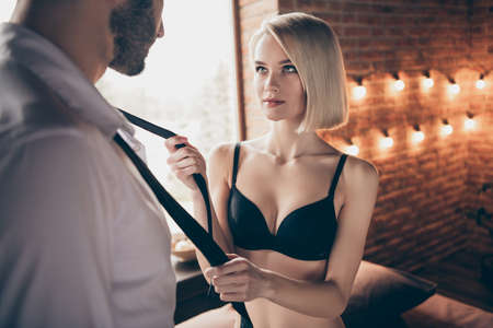 Portrait of two person nice-looking lovable sweet stunning gorgeous attractive feminine lady teasing businessman successful guy in loft brick industrial style interior room house hotel indoors Stock Photo