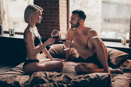 Alone weekend vacation family wife husband. Photo of beautiful stylish blonde haired bob attractive horny charming elegant lady looking into eyes of her beloved bearded sporty fit virile flirty macho