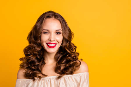 Close-up portrait of her she nice attractive lovely magnificent stunning winsome cheerful cheery wavy-haired lady flirting isolated over bright vivid shine yellow background
