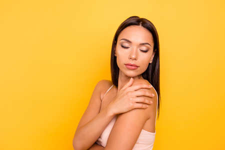 Close up side profile photo beautiful she her lady big lips eyes closed overjoyed skin condition spa procedure treatment wear casual pastel tank-top outfit clothes isolated yellow bright background