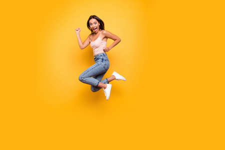 Full length body size view photo cute charming lady feel rejoice enjoy spring summer react scream shout feel satisfied glad content summer isolated dressed fashionable modern outfit yellow background Stock Photo
