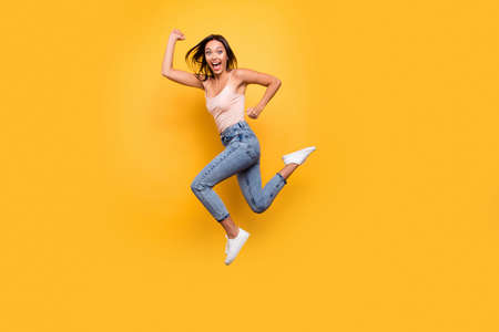 Full length body size view photo playful pretty teen energetic trendy active teenager beautiful modern summer clothes fool joke speed hurry laugh scream shout enjoy rejoice isolated bright background 写真素材