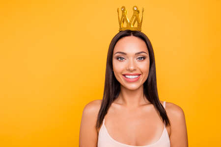 Close up photo beautiful amazing she her lady toothy smile leader chief gold crown head famous person pop star girls run world concept wear casual pastel tank-top isolated yellow bright background Stock Photo