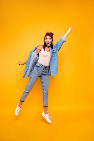 Full length body size view photo carefree careless playful teen hold hand raise fist hand impressed wonderful incredible news scream shout grimace modern summer clothes isolated bright background