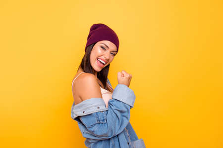 Close up side profile photo beauty she her lady ecstatic hand arm raised air unbelievable goal favorite football team wear casual pastel tank-top jeans denim jacket isolated yellow bright background Stock Photo