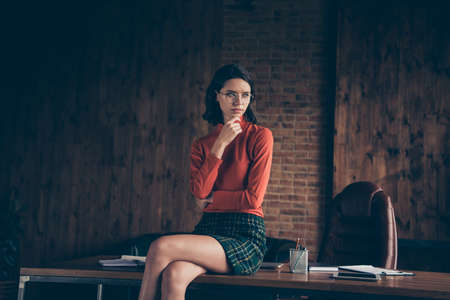 Portrait of focused pensive lady real estate agent dream dreamy thought start up touch thin brunette hair hairstyle dressed casual checkered skirt cotton sweater industrial
