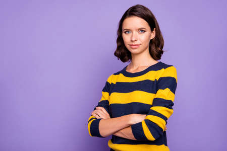 Close up photo beautiful amazing she her lady ideal appearance sincere kind arms crossed easy-going listening great good news wear blue yellow striped pullover isolated violet purple background Banco de Imagens