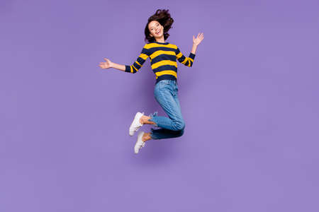Full length body size side profile photo beautiful amazing she her lady jump high flight party person people playful mood wear blue yellow striped pullover isolated violet purple background 写真素材 - 122697528
