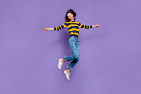 Full length body size side profile photo beautiful she her lady yell scream shout jump high flight party person people playful mood wear blue yellow striped pullover isolated violet purple background 写真素材 - 122697531