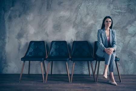 Her she nice gorgeous chic stylish top executive manager marketer financier economist brunette lady waiting appointment meeting at industrial loft style interior room work place station concrete wall Stock Photo - 122697549