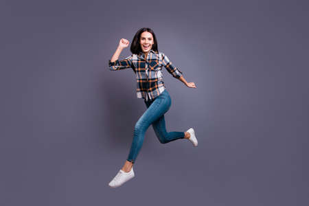 Full length body size photo beautiful she her lady hold raise hands arms flight air rushing free low prices shopping mall store wear casual jeans denim checkered plaid shirt isolated grey background 写真素材