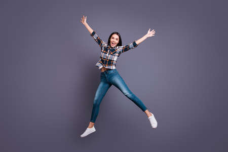 Full length body size photo beautiful she her lady hold raise hands arms raised flight air star shape figure celebrating party wear casual jeans denim checkered plaid shirt isolated grey background