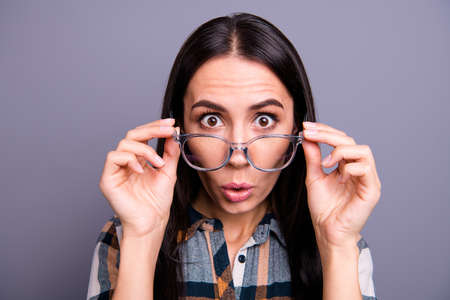 Close up photo of funny millennial youth isolated touch specs impressed by novelty incredible ask what wonder astonished cant believe curious wear checked clothes isolated on grey background Standard-Bild - 122698537