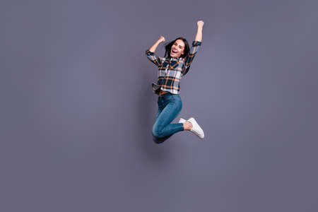 Full length side profile body size photo beautiful yell she her lady hold raise hands arms raised flight air football match game wear casual jeans denim checkered plaid shirt isolated grey background 写真素材 - 122698553