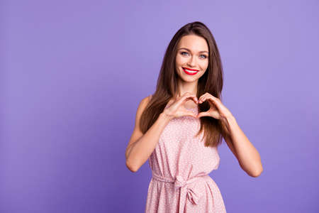 Portrait of her she nice-looking charming cute sweet winsome attractive groomed cheerful cheery positive tender lady showing heart sign isolated over pastel violet background