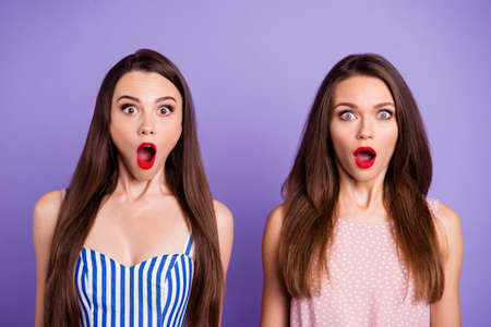 Close-up portrait of nice-looking charming cute lovely glamorous attractive amazed crazy ladies sale discount opened mouths stare eyes isolated over pastel violet background 写真素材