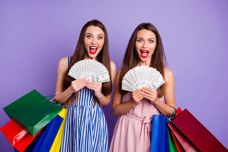 Close up photo two people beautiful she her models ladies hands arms pay fan usa bucks many packs scream shout yell glad rich wealthy wear colorful dresses isolated purple violet bright background