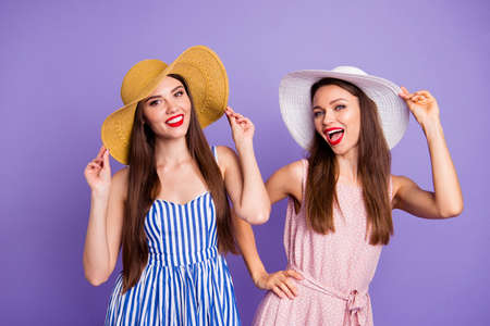 Close up photo two beautiful funky she her models classy ladies long straight hair perfect sunny weather go walk move step park wear sun hats summer dresses isolated purple violet background Reklamní fotografie