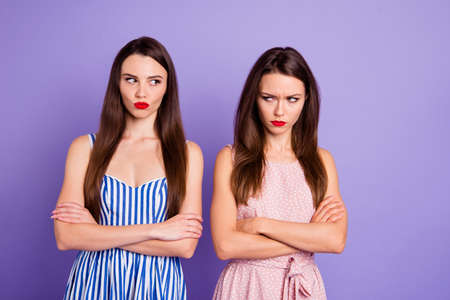 Close up portrait two people amazing beautiful she her lady classy chic had fight not speak tell talk each other offense wear pretty colorful dresses isolated purple violet bright vivid background