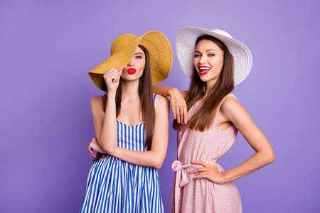 Close up photo two beautiful funny funky she her models classy ladies hide eye send air kiss perfect sunny weather coquettish mood wear sun hats summer dresses isolated purple violet background Reklamní fotografie