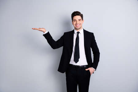 Portrait of excited satisfied entrepreneur freelancer collar have promotion advertisements advice decide choose suggest demonstrate information display formal wear isolated on silver background Stockfoto