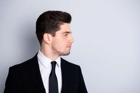 Close up side profile photo amazing he him his macho attractive handsome look watch wondered empty space not smiling wear white shirt black suit jacket tie formalwear isolated bright grey background Reklamní fotografie